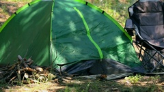 Tourist camping in the woods with a tent Stock Footage