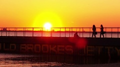 Girls walking St Kilda Pier, Melbourne. Sunset, Slow Motion Stock Footage