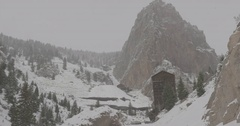 Wooden hut between the snow-covered mountains in Colorado Stock Footage