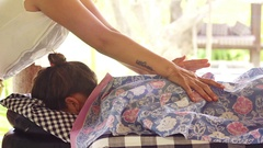 Balinese woman doing indonesian massage for tourist Stock Footage