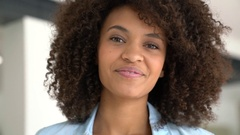 Attractive smiling mixed-race girl at home Stock Footage