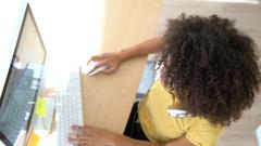 Upper view of woman working on desktop computer Stock Footage