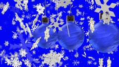 Decorations for Christmas trees and slowly falling snowflakes on blue Stock Footage