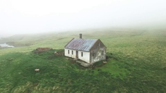 Aerial of old house on a green hill Stock Footage