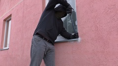 Robber with crowbar near widow Stock Footage