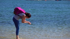 Girl Playing With  Seashell Stock Footage