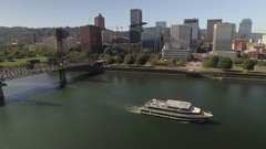 Aerial of Portland city and ferry moving in Willamette River Stock Footage