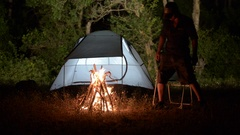 Camping Fire man nature night tent in forest Stock Footage