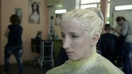Close Up Young Girl Sitting in a Beauty Salon with Painted Head Stock Footage