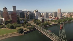 Aerial of Portland cityscape Hawthorne Bridge over Willamette River Stock Footage