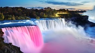 The famous Niagara Falls in the evening. Spotlights illuminate the waterfall is Stock Footage
