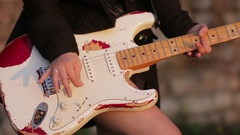 Female hands with guitar playing hard-rock outside Stock Footage