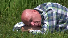 Businessman Resting Lay Down in Green Grass Sleeping Deep in a Vacation Day. Stock Footage