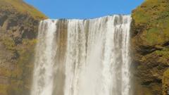 Close up view of powerful flow of famous icelandic waterfall Skogafoss in sunny Stock Footage