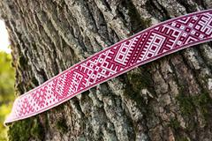 National symbols of Latvia - Lielvarde belt around the tree Stock Photos