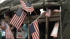 Kids Waving USA Flags From Military Vehicle Stock Footage