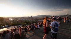 Many people watching the sunset from Michelangelo Square on July 2016 in Floren Stock Footage