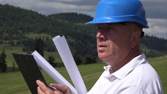 Engineer with Plans Taking Clipboard  Notes and Check Details of Building Site. Stock Footage