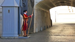 Guard Papal Swiss guard, standing at the door in the Vatican Stock Footage