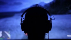Gamer Plays Video Games Isolated in a Dark Room Stock Footage