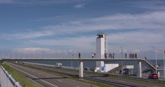 Pedestrian bridge causeway enclosure dam Afsluitdijk Stock Footage