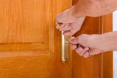 Unlocking the door Stock Photos