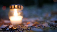 Votive candle on grave, Grave candle Stock Footage