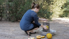 Woman hands shredding organic fodder for livestock with old metal grater tool. Stock Footage