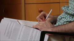 Man writing notes during lecture - Medium Shot Stock Footage