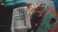 The composition: morning news, coffee in Chemeks, coffee beans Stock Footage