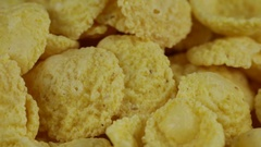 Rotating corn chips , macro view food background Stock Footage