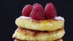 Rotation healthy homemade cheese pancakes with raspberry Stock Footage