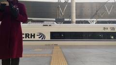 CRH train leaving platform Stock Footage