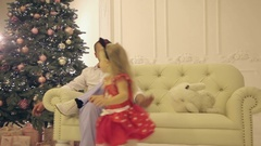 Father playing with his daughter on the eve of the new year Stock Footage