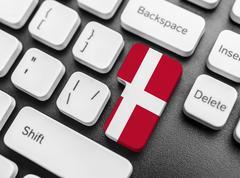 Enter key button with Flag of Denmark. Stock Photos