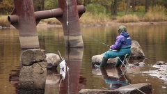 Fishing on the river in the autumn at the bait Stock Footage