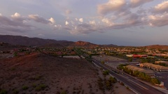 4K Drone Aerial Desert Suburb Cloudy Sunset Stock Footage