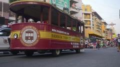 Bangkok tram and tourists walking at Khao San Road Stock Footage