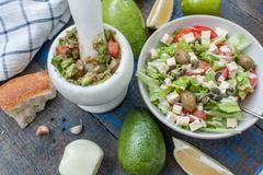Guacamole - latin american sauce and ingredients  and green salad Stock Photos