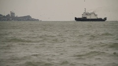 The ship in the sea on the horizon. Mainly cloudy. Sea. Wind. Russian Crimea-02. Stock Footage