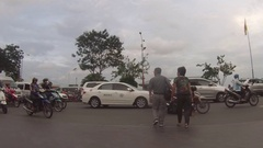 Couple cross road in Ho Chi Minh City Stock Footage