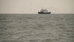 The ship in the sea on the horizon. Mainly cloudy. Sea. Wind. Russian Crimea. Stock Footage