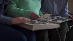 Disabled with nurse viewing family photo album Stock Footage