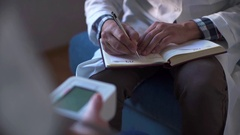Measuring the blood pressure by doctor with pressure gauge Stock Footage