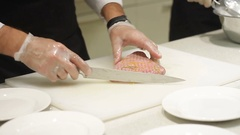 Professional chef hands cutting cooking red fish fillets tuna Stock Footage