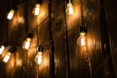 Retro Lamp With Plug And Cable Hanging On The Wooden Wall Stock Photos