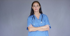 Attractive friendly young female doctor Stock Footage