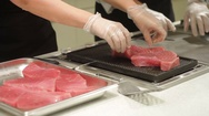 Chef hands take fillets tuna on grill Stock Footage