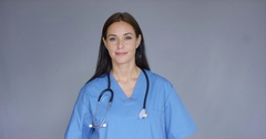 Doctor with stethoscope holding package Stock Footage