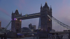 Imposing Tower Bridge at Crepuscle with Cars Traffic and Tourists Walking. Stock Footage